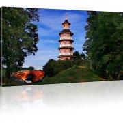Turm im Park Bild auf Leinwand